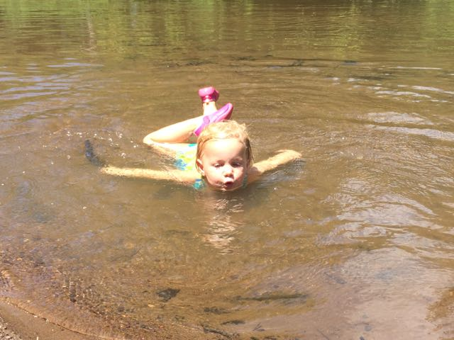 splashing in the neuse river beach