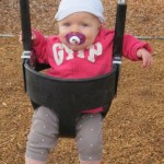 Ashley trying out the new swings
